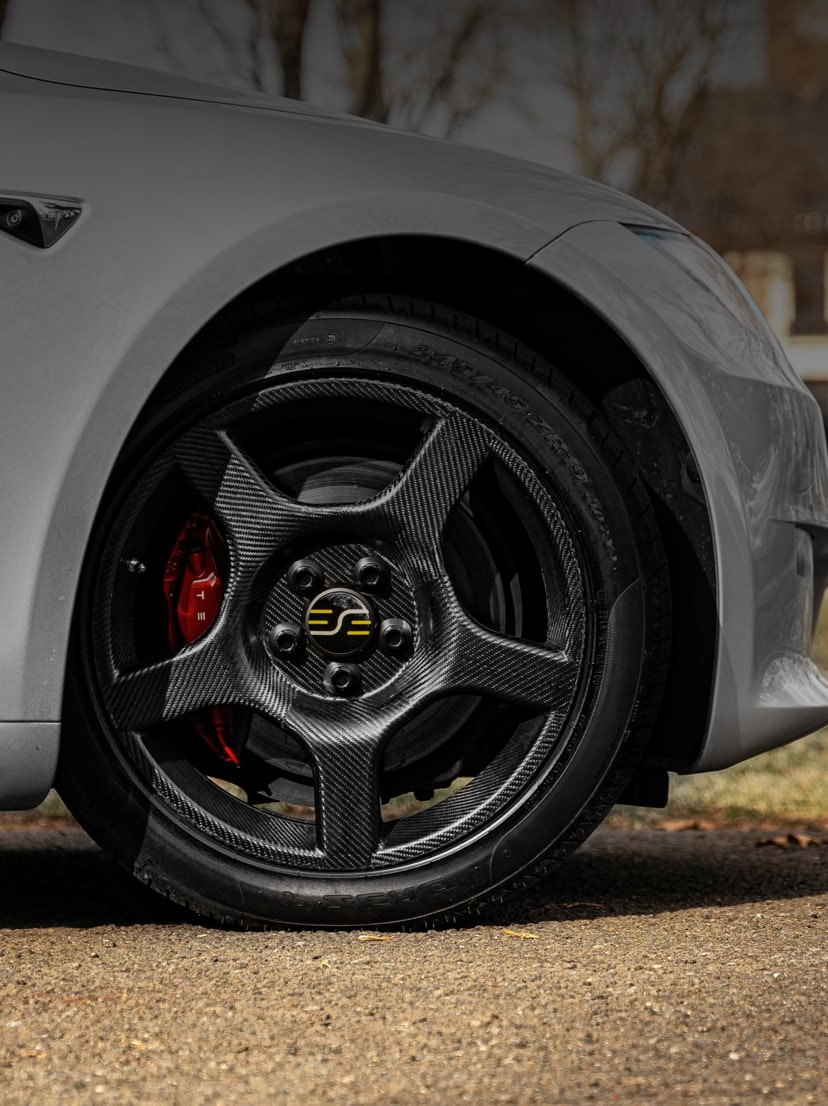 the front-end of a car with a carbon fiber wheel