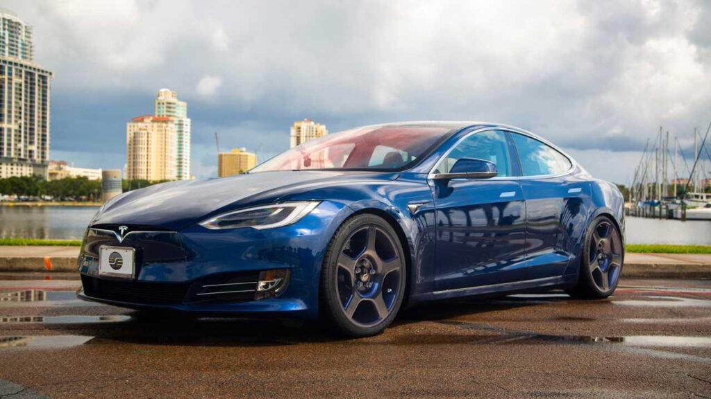 a blue Tesla with carbon fiber wheels